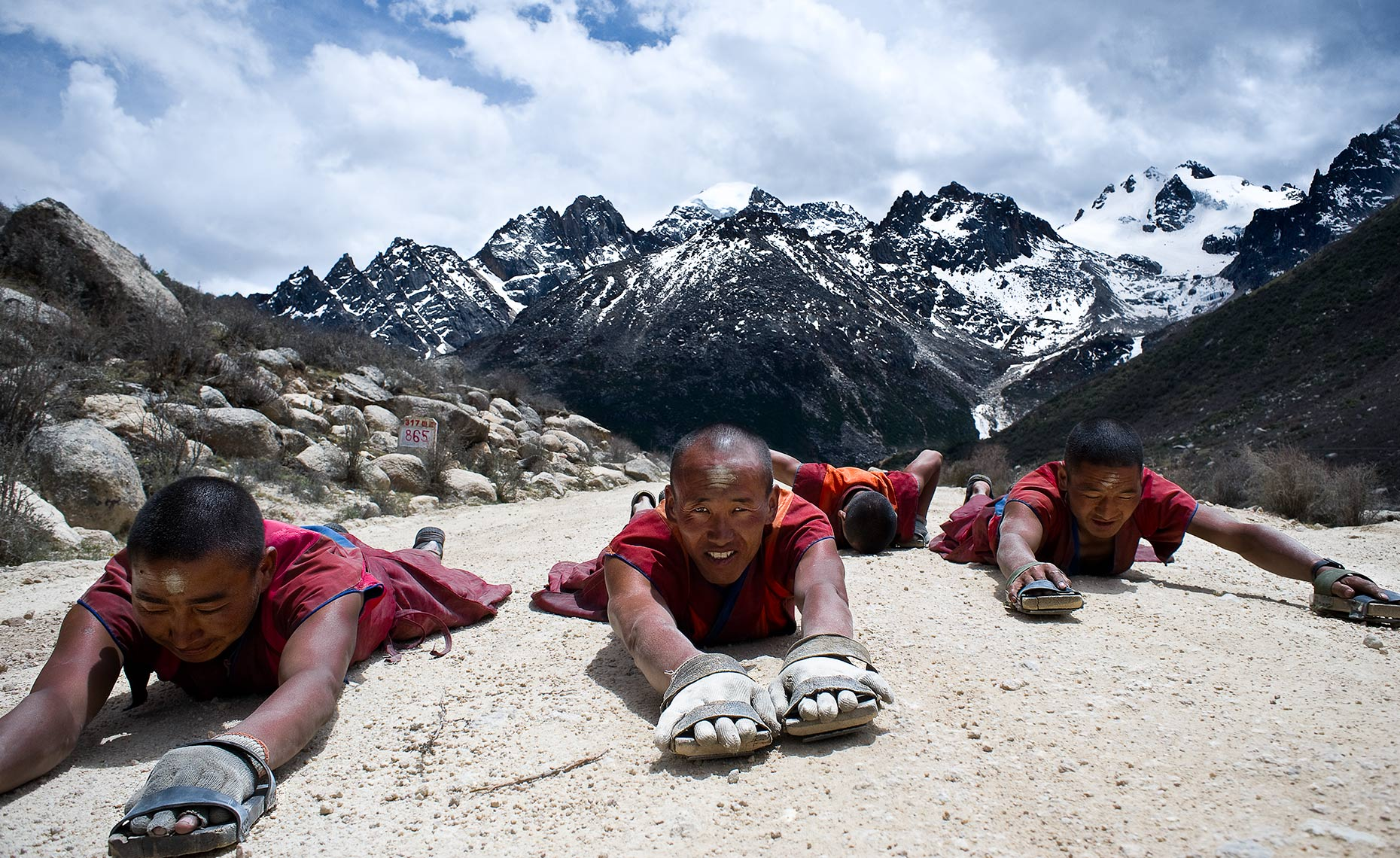 Tibetan Buddhist monks crawling for two years on their way to Lhasa Tibet.. Photo © Konstantino Hatzisarros 2010