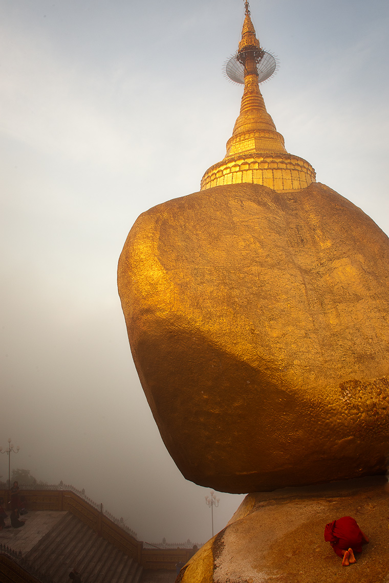 Buddhist Monk Praying In Front of Golden Rock, Kyaktiyo, Burma