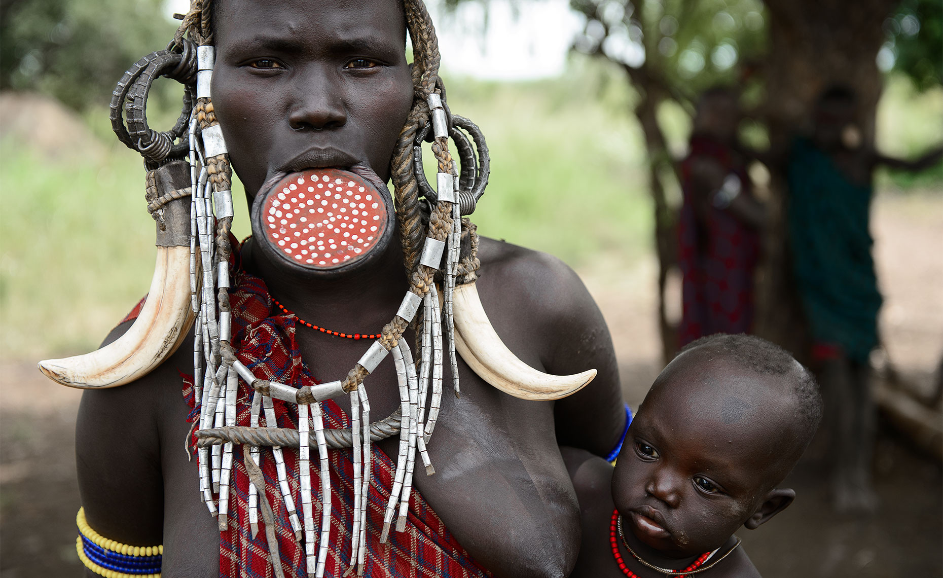 mursi tribe girl with lip plate at mago park, ethiopia