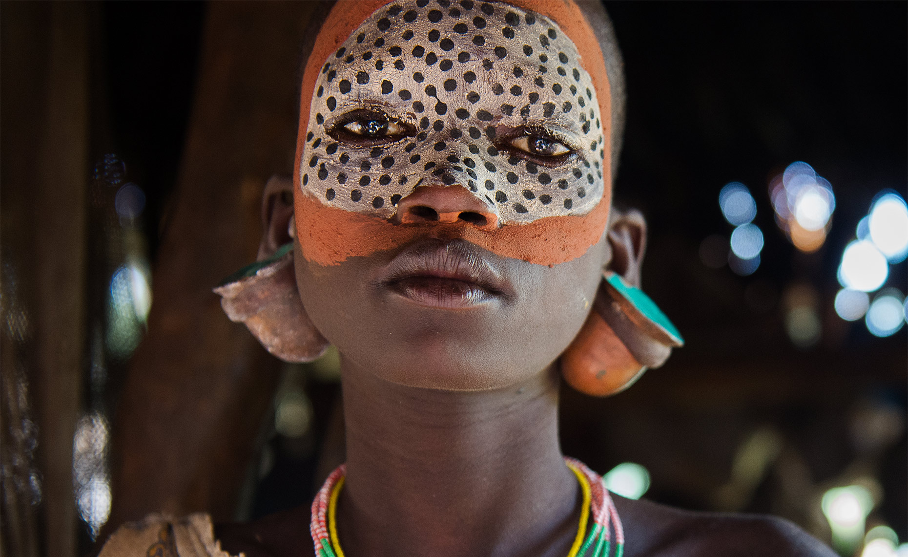 suri tribe girl with face paint at omo park ethiopia