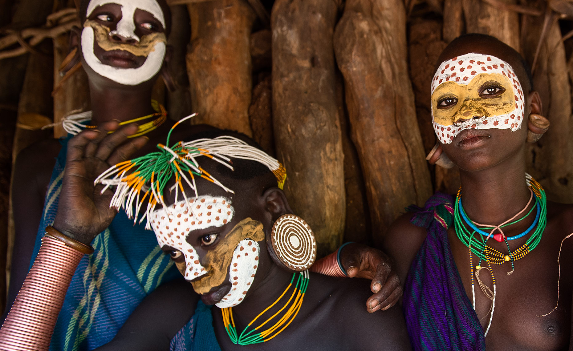 suri tribe with face paint omo park ethiopia