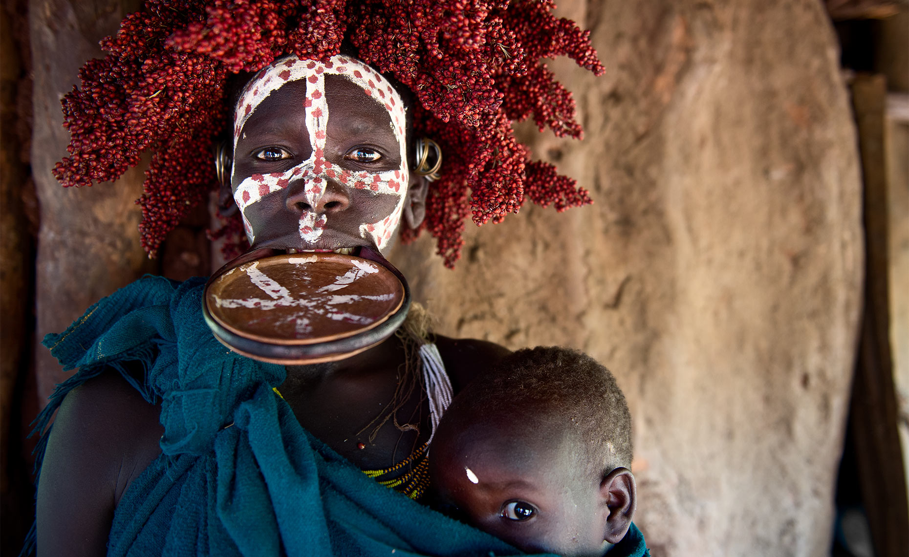 suri tribe woman with lip plate and face paint omo park ethiopia