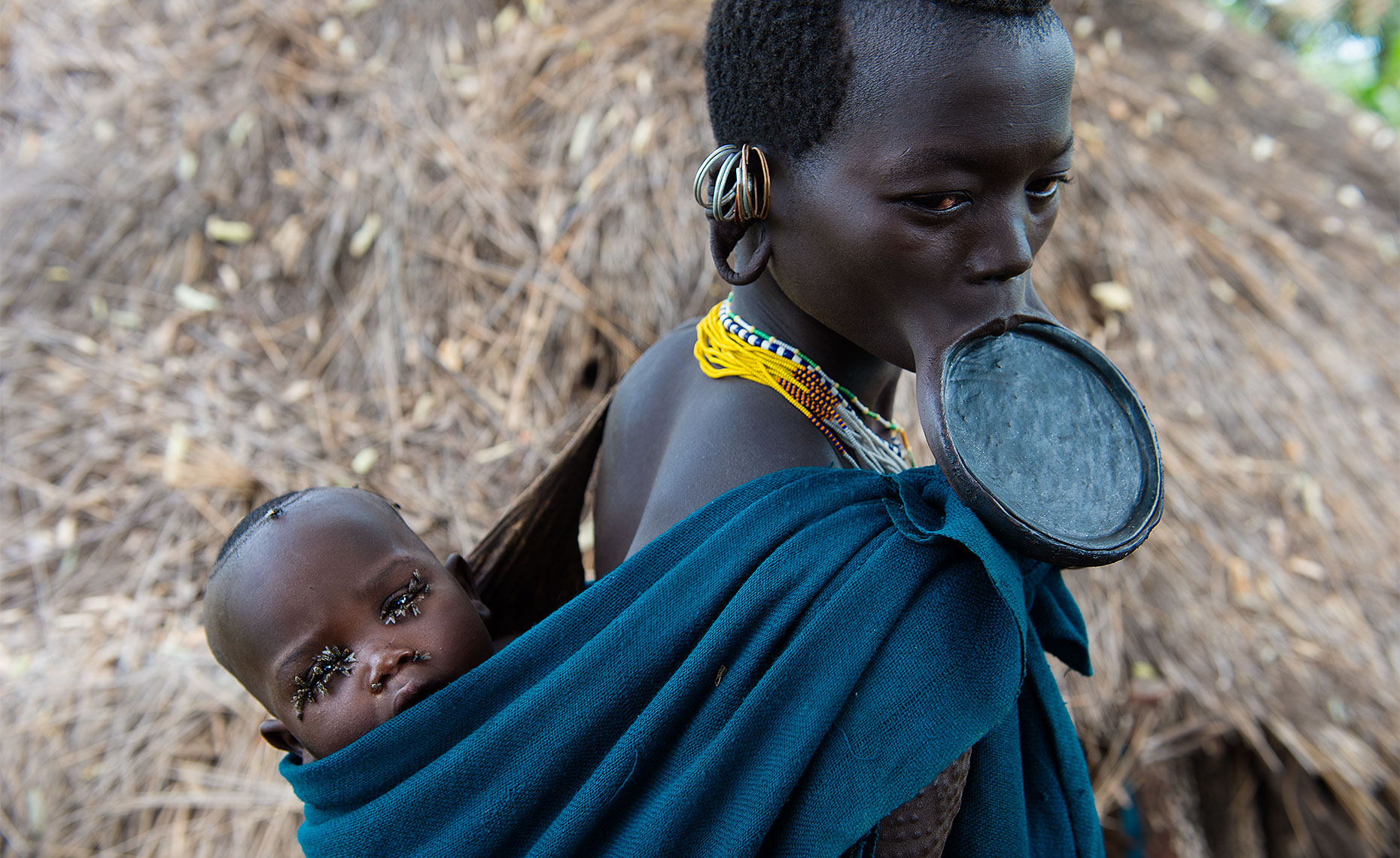 suri tribe woman with lip plate at omo park ethiopia